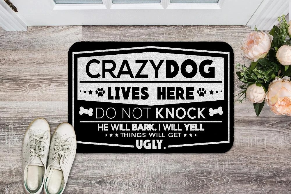 Crazy dogs live here do not knock doormat 1